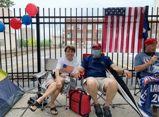 Mary and Ken Legan sit in line for President Donald Trump's Saturday rally in Tulsa, Okla.