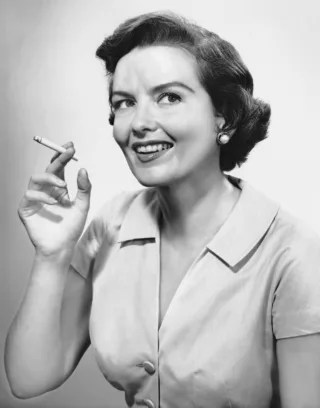 UNITED STATES - CIRCA 1950s:  Portrait of woman holding cigarettte.  (Photo by George Marks/Retrofile/Getty Images)