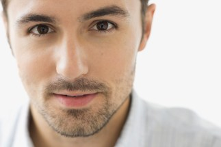 Media Bakery ID: HER0003023 Close-up portrait of confident man