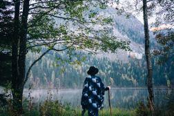 26 Oct 2015, Austria --- Woman near the mountain lake in Austria --- Image by © Oleh Slobodeniuk/Corbis