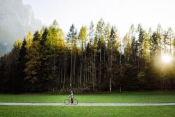 Austria --- Woman riding on mountain bike in national park --- Image by © Oleh Slobodeniuk/Corbis