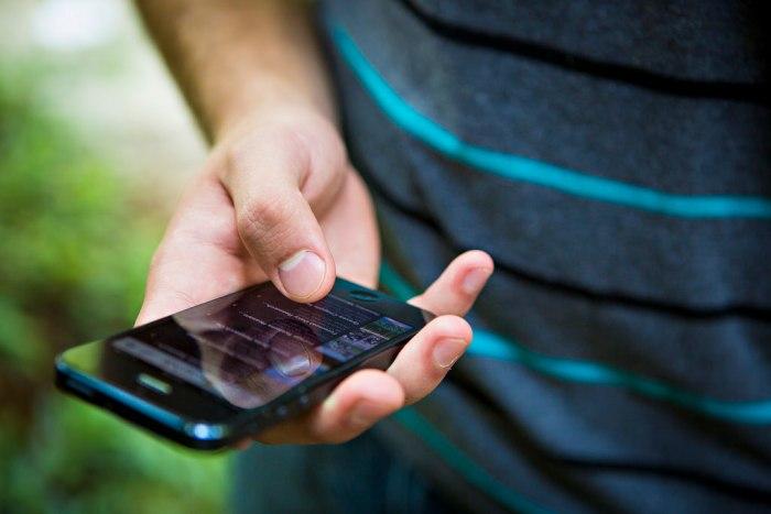 man-on-mobile-phone-reading-news