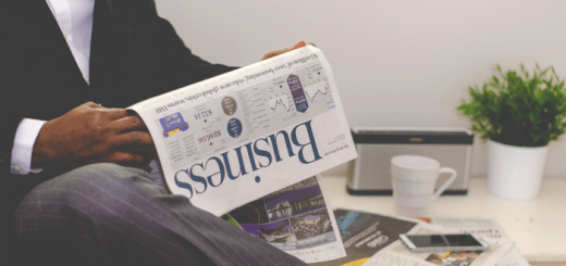 Businessman reading the business section of a newspaper