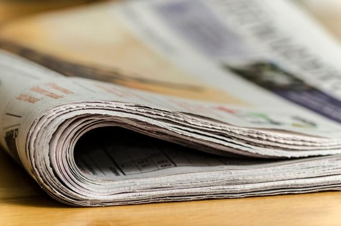 folded newspaper on a desk