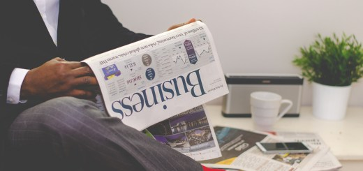 business man reading the business section of a newspaper