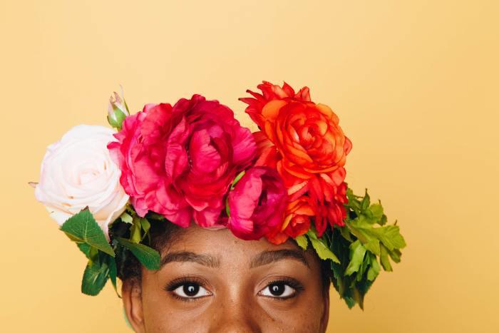 black woman wearing a flower crown