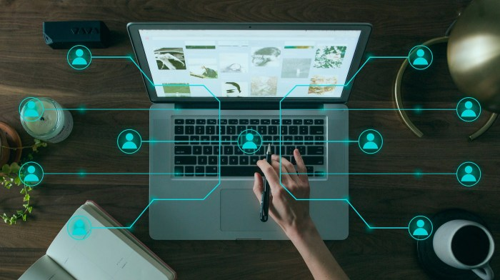 Image of a person using a laptop with an overlay of connected people icons