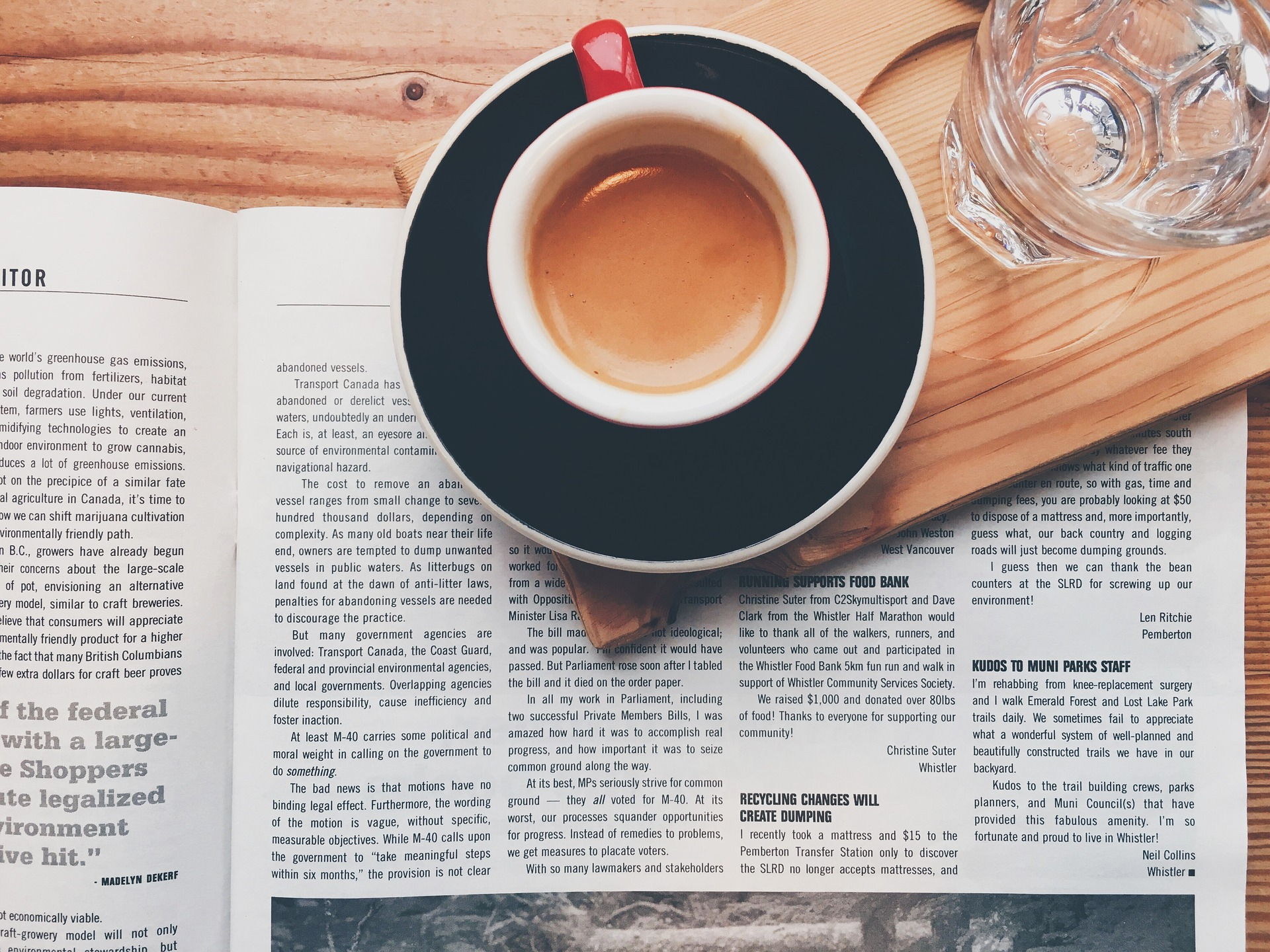 Photo of a cup of coffee on top of an open magazine