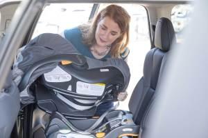 Woman installing a car seat