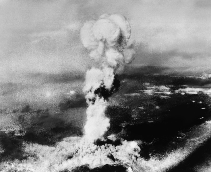 Description of  Aug. 6, 1945: This picture made from the town of Yoshiura on the other side of the mountain north of Hiroshima, Japan, shows the smoke rising from the explosion of the atomic bomb at Hiroshima. It was picked up from an Australian engineer at Kure, Japan. Note the radiation spots on the negative caused by the explosion of the A-bomb, almost ruining the film. (AP Photo)