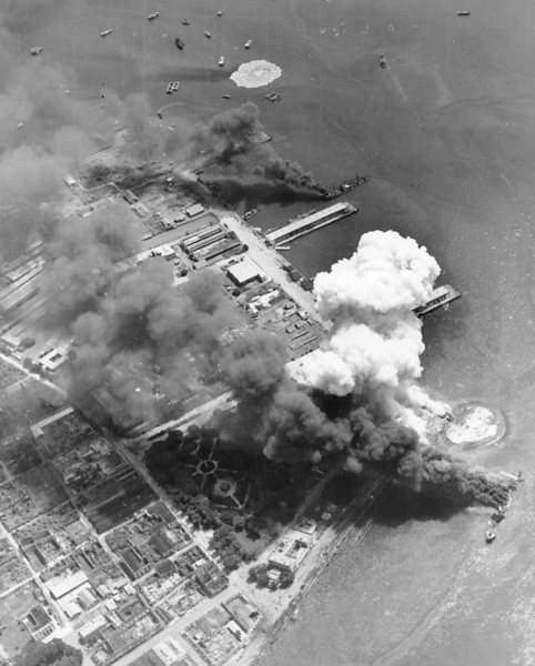 Description of  September 13, 1944: Japanese-occupied harbor of Cebu is under attack by U.S. Navy carrier-based fighter planes, at Cebu island, Philippines. (AP Photo)