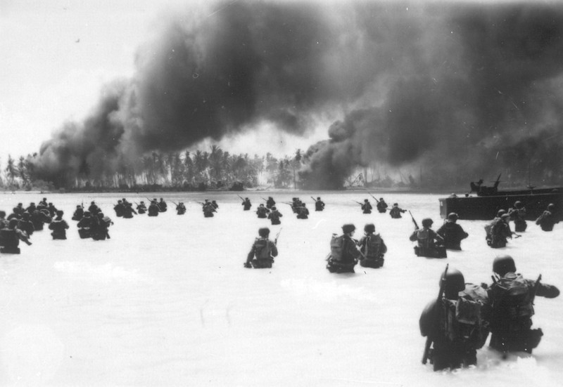 Description of  November 20, 1943: Under attack from Japanese machine gun fire on the right flank, men of the 165th Infantry are seen as the wade through coral bottom water on Yellow Beach Two, Butaritari, during the assault on the Makin atoll, Gilbert Islands. (AP Photo)