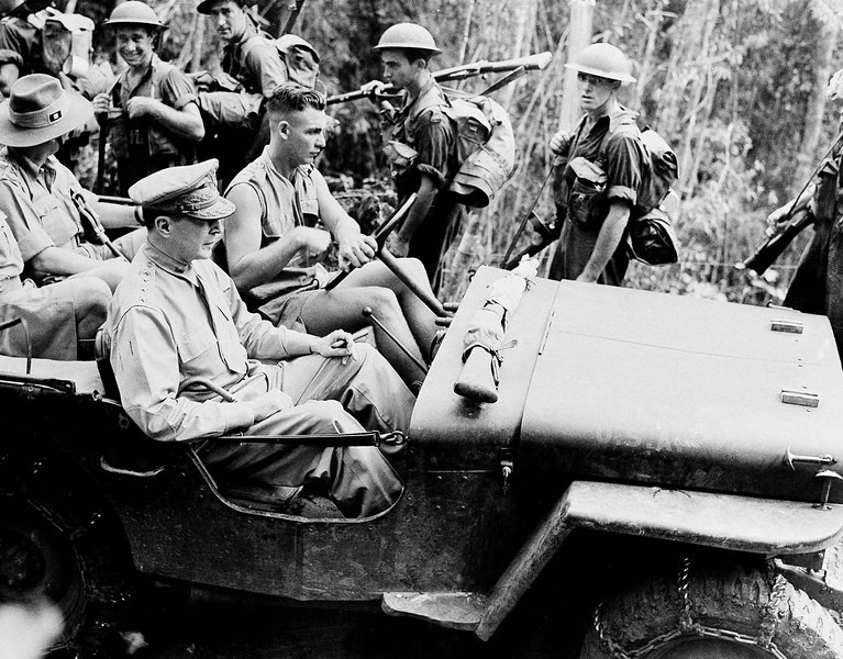 Description of  Nov. 3, 1942: Pushing through New Guinea jungles in a jeep, General Douglas MacArthur inspects the positions and movements of United Nations Forces, who would push the Japanese away from Port Moresby and back over the Owen Stanley Mountain range. (AP Photo)