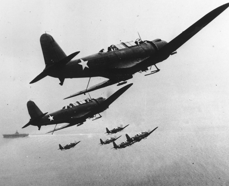 Description of  October 16, 1942: Six U.S. Navy scout planes are seen in flight above their carrier. (AP Photo)