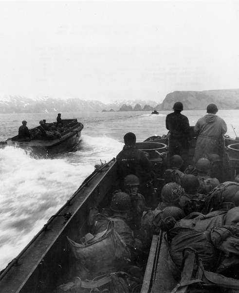 Description of  May 11, 1943: American invasion troops of the 7th Infantry Division approach a landing area code-named Beach Red in the western arm of Holtz Bay, on Japanese-occupied Attu island in Alaska. (AP Photo)