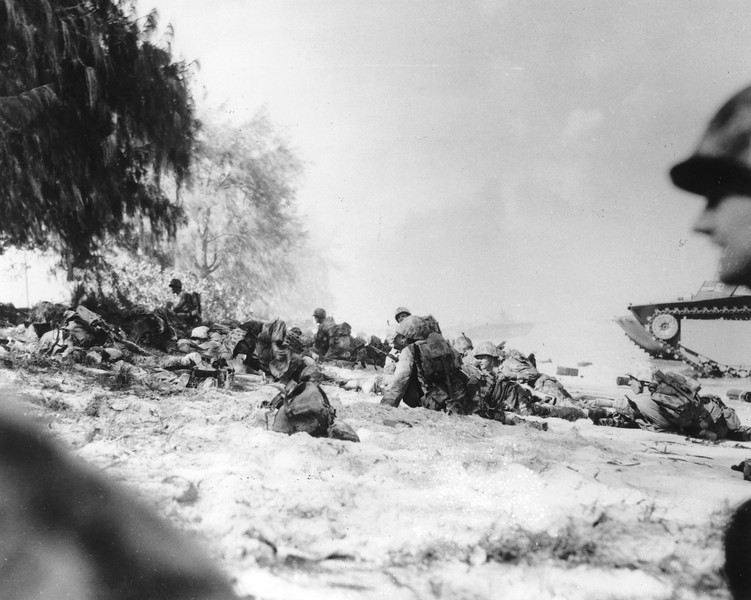 Description of  June 1944: U.S. Marines move up the beach on Saipan under heavy machine gun fire, during landing operations at the island of the Mariana group. (AP Photo)