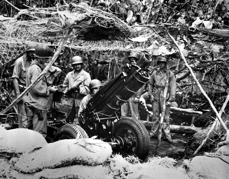 Description of  Oct. 29, 1942: U.S. Marines man a .75 MM gun on Guadalcanal Island in the Solomon Islands during World War II. (AP Photo)