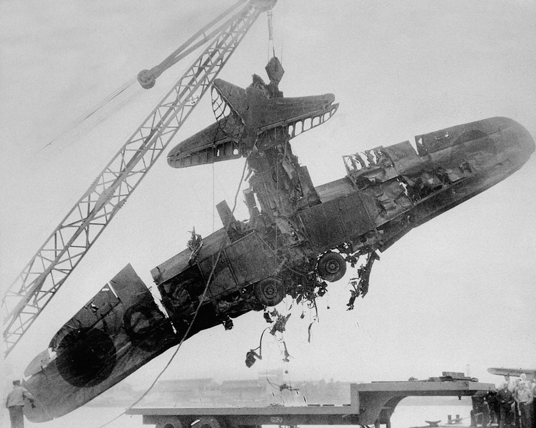 Description of  Wreckage, identified by the U.S. Navy as a Japanese torpedo plane , was salvaged from the bottom of Pearl Harbor following the surorise attack Dec. 7, 1941. (AP Photo)