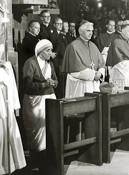 Description of . A photo taken during the 85th German Catholics Days in Freiburg between 13 and 17 September 1978 shows the Cardinal Joseph Ratzinger (C) praying next to Mother Teresa. Ratzinger was elected the 265th pope of the Roman Catholic Church 19 April 2005 at the Vatican City, becoming Pope Benedict XVI. KNA-BILD/AFP/Getty Images