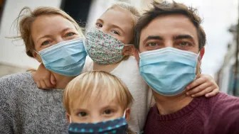 picture of family wearing face masks