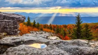 Sunrise from high atop Dolly Sods Wilderness area in West Virginia with Sunbeams and reflections