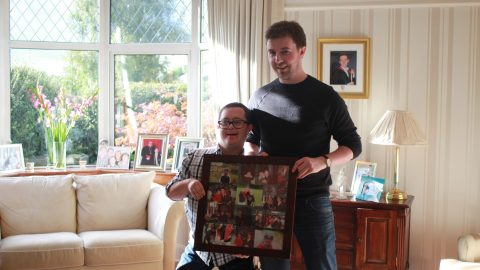 Chris with his PA, holding a photo collage together