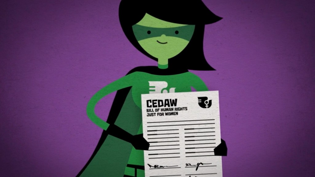 Close up of CEDAW superhero holding up a signed Bill of Human Rights Just For Women