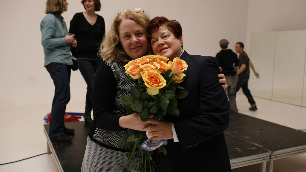 Diane Torre and Katarina Peters, together and holding flowers