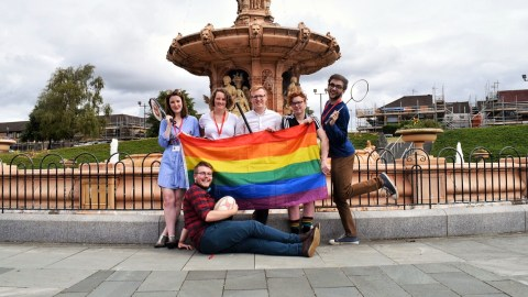 Team photo of 6 LGBT+ activists during Glasgow 2018 European Championships with the Rainbow Flag