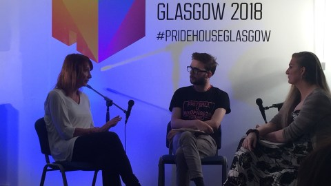 Project activist sitting with Philippa York and journalist during interview at Pride House Glasgow