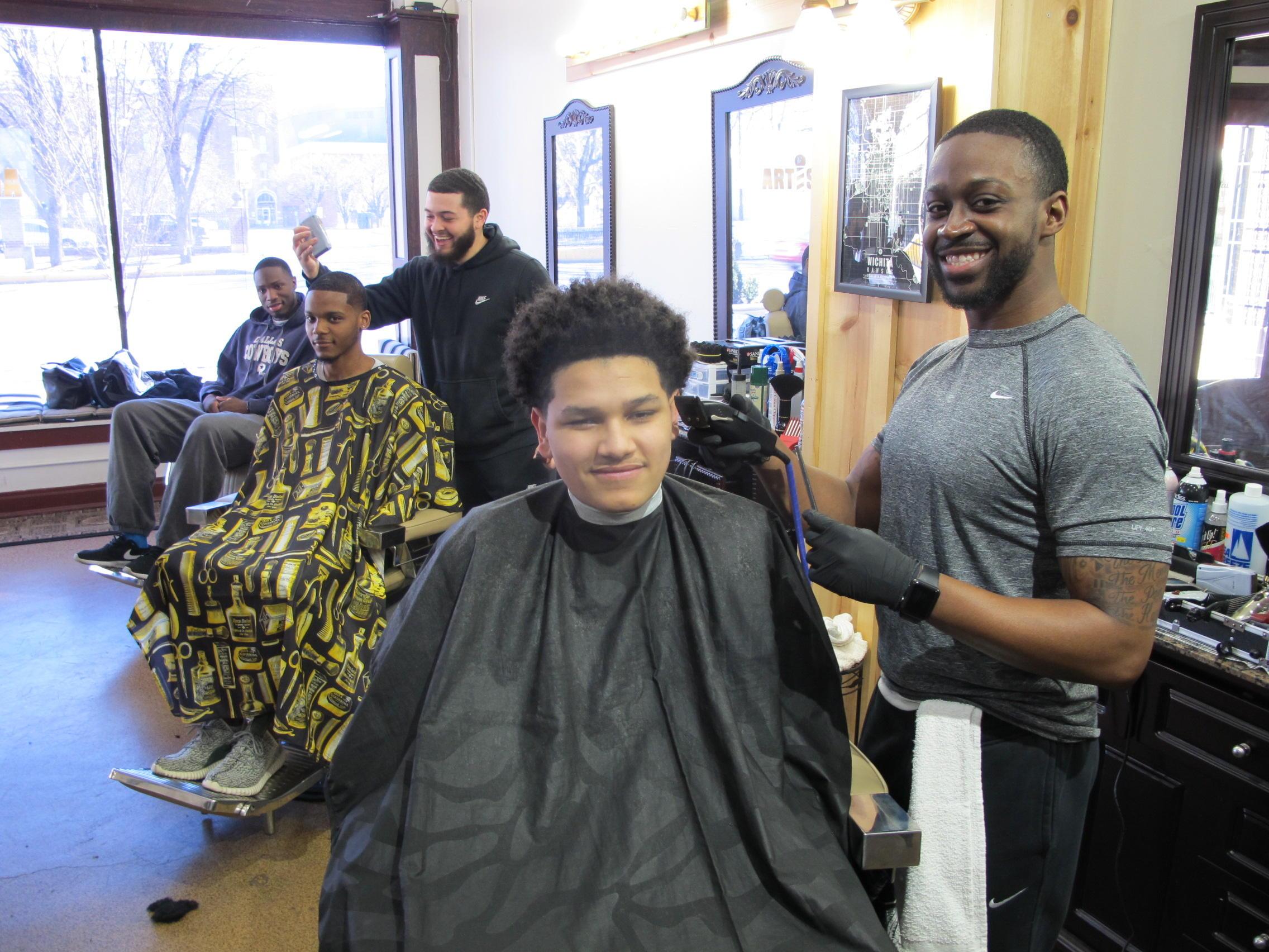 Hot Towels And Tapered Cuts Local Barbershop Wel es NCAA