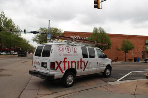 An Xfinity van in Longmont's downtown. The city is investing in its own broadband utility which is considerably faster and cheaper than existing options.