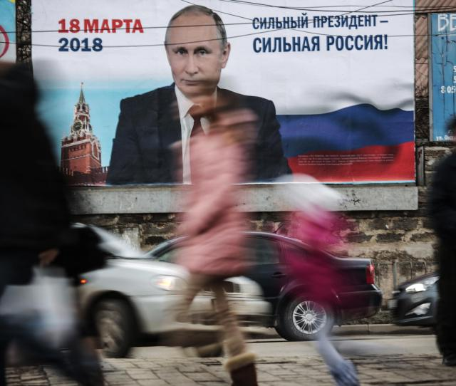 Pedestrians Pass By A Billboard With An Image Of Russias President Vladimir Putin And Lettering Strong President Strong Russia In Simferopol Crimea