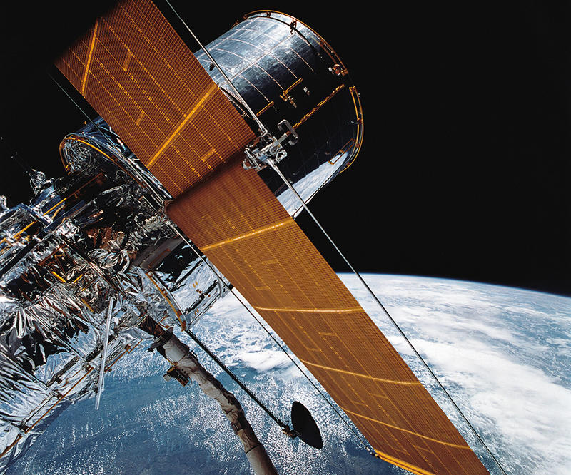 The Hubble Space Telescope, pictured in one of the first photos released from NASA in 1990, is celebrating its 25th anniversary on Friday, April 24. Scientists hope the telescope will remain functional for at least five more years.