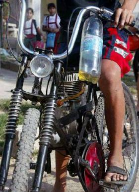 A Cuban rikimbili-- the word for bicycles that have been converted into motorcycles. The engine of 100cc's or less typically is constructed out of motor-powered, misting backpacks or Russian tank AC generators.