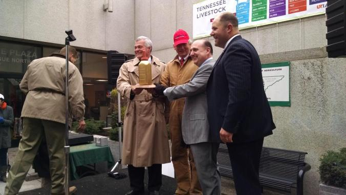 State Rep. Andy Holt, right, presents state Sens. Jim Tracy, Frank Niceley and Paul Bailey with the Golden Bottle Trophy.