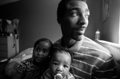 Guy Miller getting ready for afternoon naptime with daughter Nijeyah and son Guy Jr. Bronx, NY.