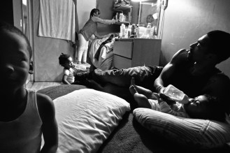 Guy Miller at home with his four children. Bronx, NY.