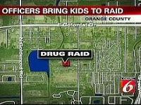 swat officers bring children on raid