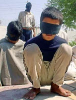 US admits holding juvenile combatants