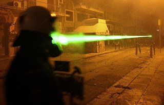greek protesters unleash the lasers