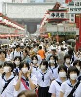 swine flu spreading in japan, forcing school closures