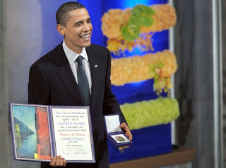obama praises & wages war while accepting peace prize