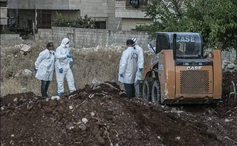 العثور على 35 جثة بمقبرة جماعية في عفرين