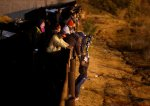 Border Patrol Agents Fire Tear Gas Into Mexico As Migrants Attempt To Cross Into U.S.