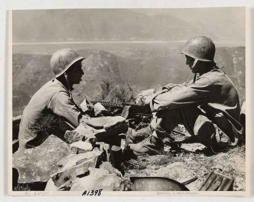 Korean War: Two marines manning a machine gun. 1950