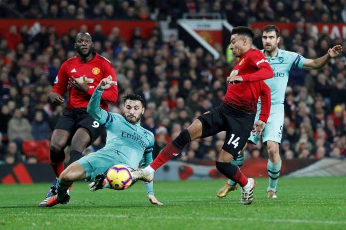 Soccer Soccer - Premier League - Manchester United vs. Arsenal - Old Trafford, Manchester, Great Britain - December 5, 2018 Manchester United Jesse Lingard marks his second goal REUTERS / Darren Staples FOR EDITORIAL USE ONLY. No use with audio, video, data, lists of meetings, unauthorized gold / club logos