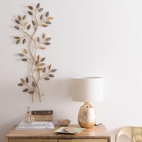 L'azienda francese specializzata in arredamento e decorazione per la casa. Decorazione Da Parete A Fronde In Metallo Dorato 37x85 Cm Livia Maisons Du Monde