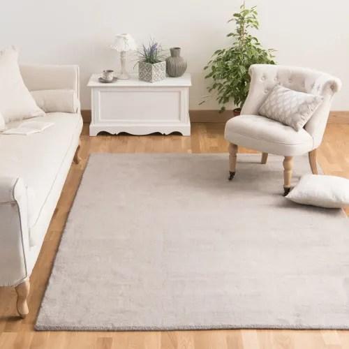 tapis a poils courts en laine beige 140 x 200 cm maisons du monde