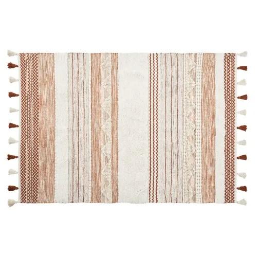 tapis en coton et laine tressee multicolore a pompons 140x200 maisons du monde